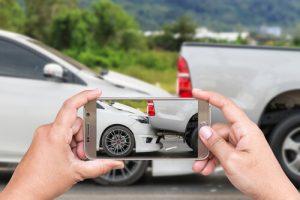 taking a photo of car crash damage
